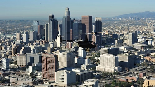 Tour helicopter flying past Los Angeles skyline