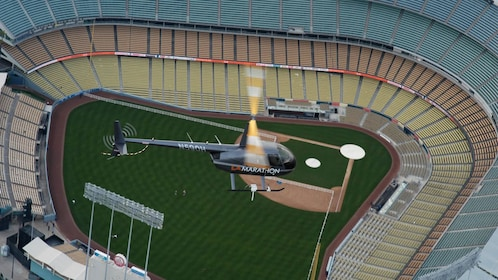 helicopter flying over a baseball stadium in Los Angeles