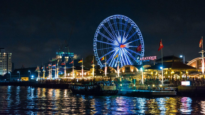 Waterfront with ferris wheel in Bangkok at night