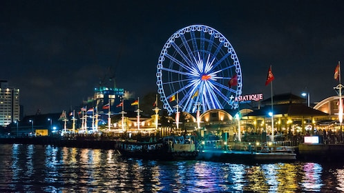 Waterfront with ferris wheel in Bangkok at night