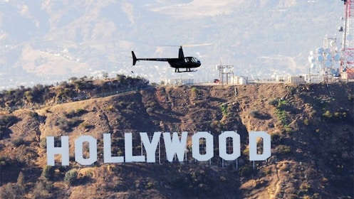 Helicopter hovering over Hollywood hill in Los Angeles
