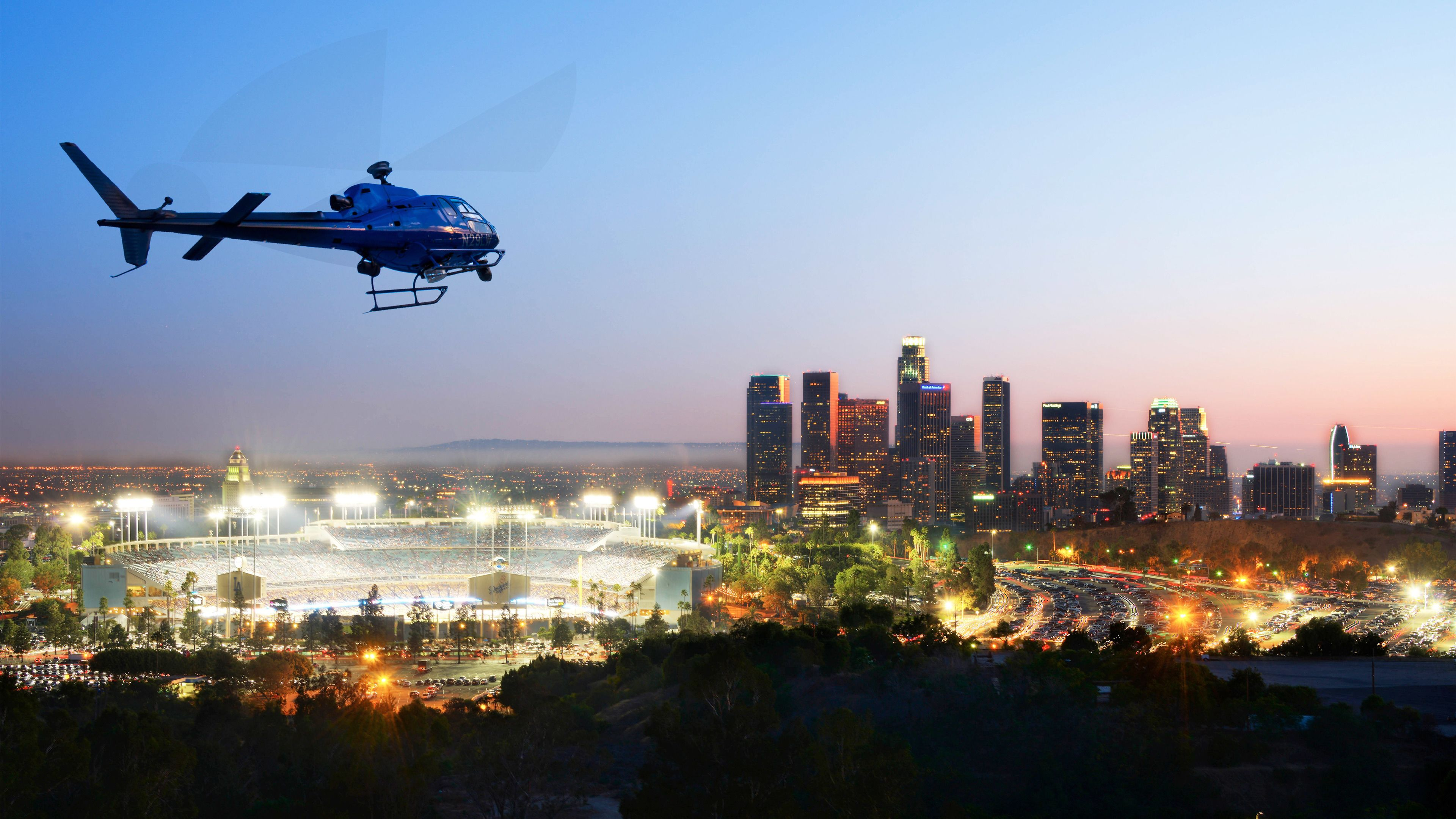Helicopter flying over the city of Los Angeles on a lit night