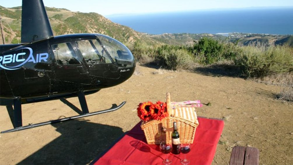 Show item 5 of 5. picnic basket set up near the grounded helicopter in Los Angeles