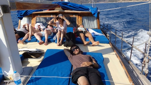 group aboard the Aphrodite sunbathing on the deck in Spain