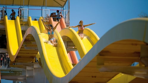women coming down a waterslide at the Aqualand Maspalomas in Spain