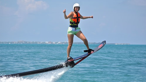 woman riding the water hoverboard in Cancun