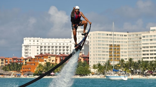 man performing stunt on his water hoverboard in Cancun