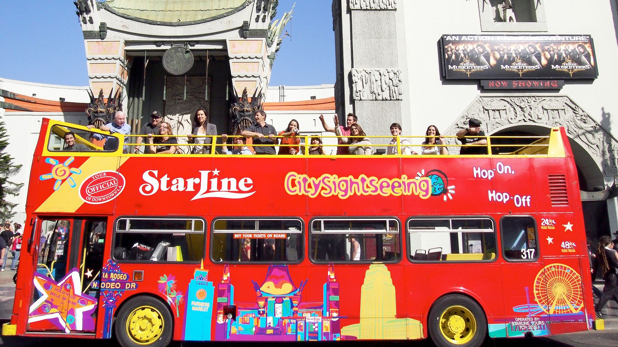 Red double decker bus on the streets of Los Angeles right outside the Chinese Theatre