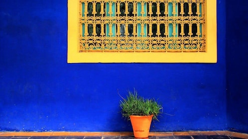 Vibrant blue building with yellow window in Marrakech
