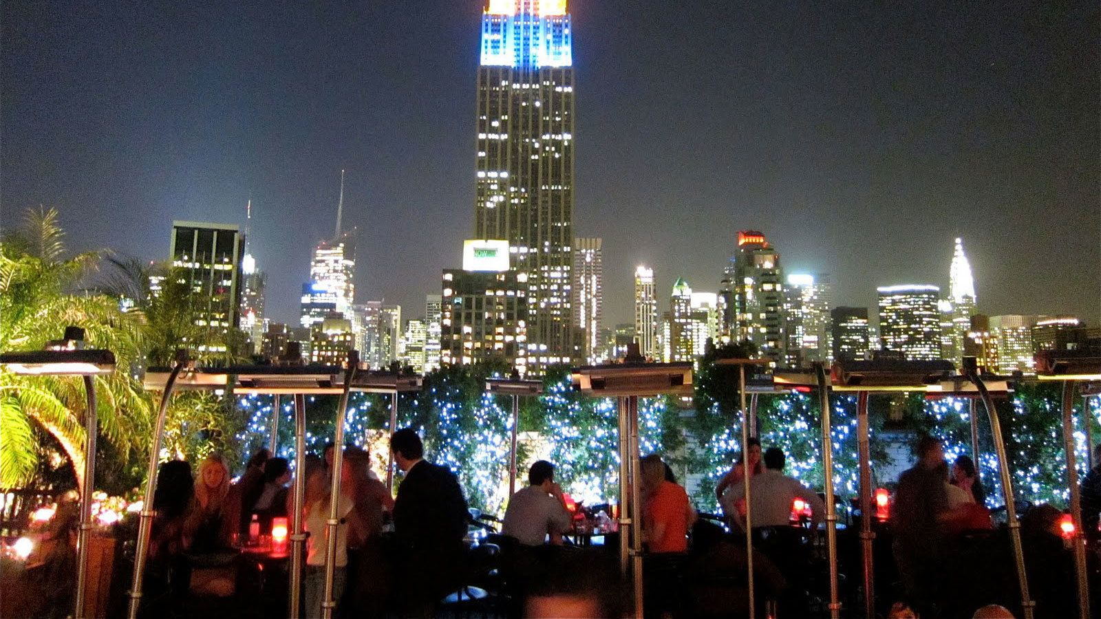 Landscape view of visitors at the monarch rooftop new york