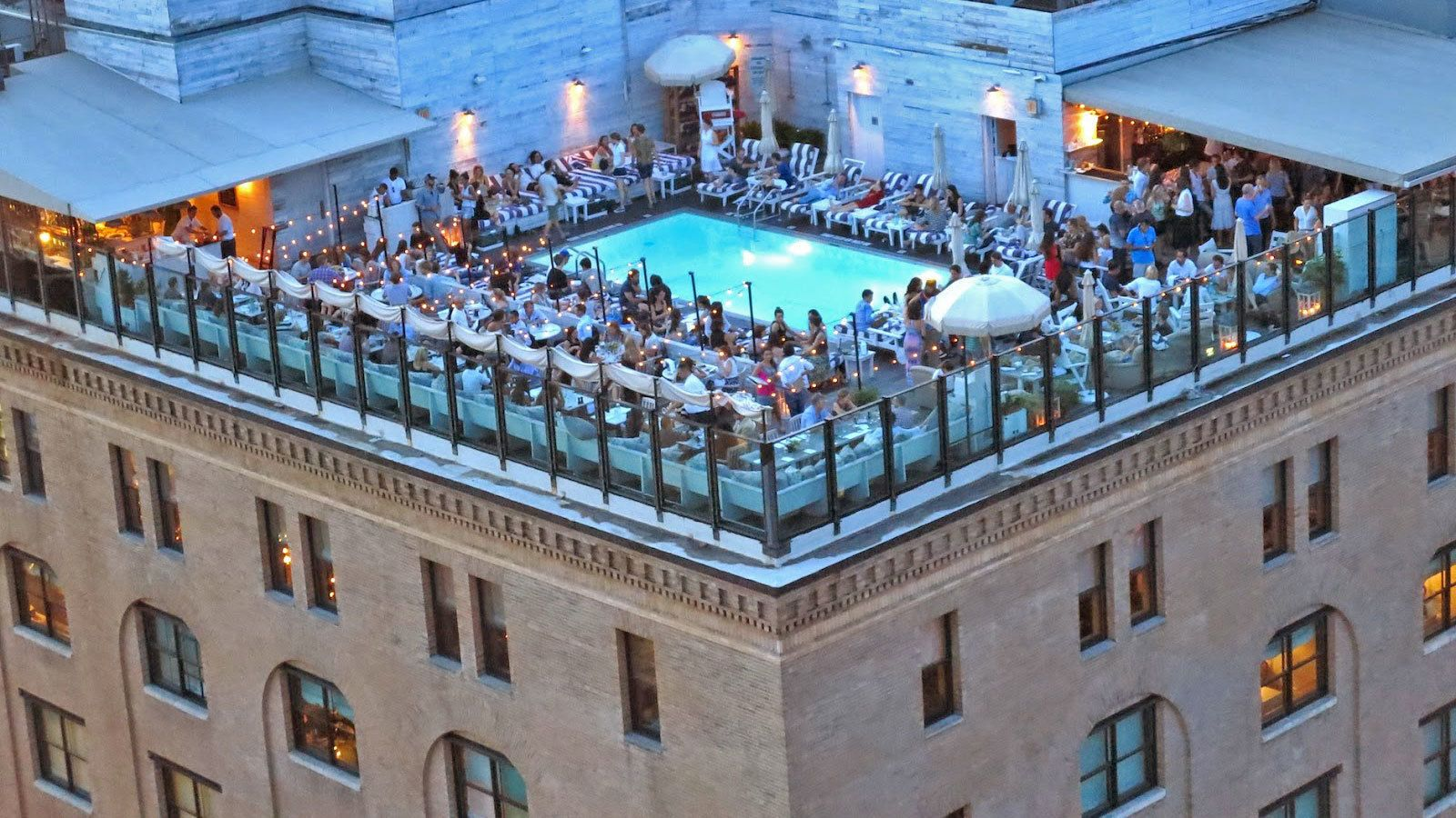 Aerial view of guests enjoying their time at the Rooftop Lounge Experience in New York