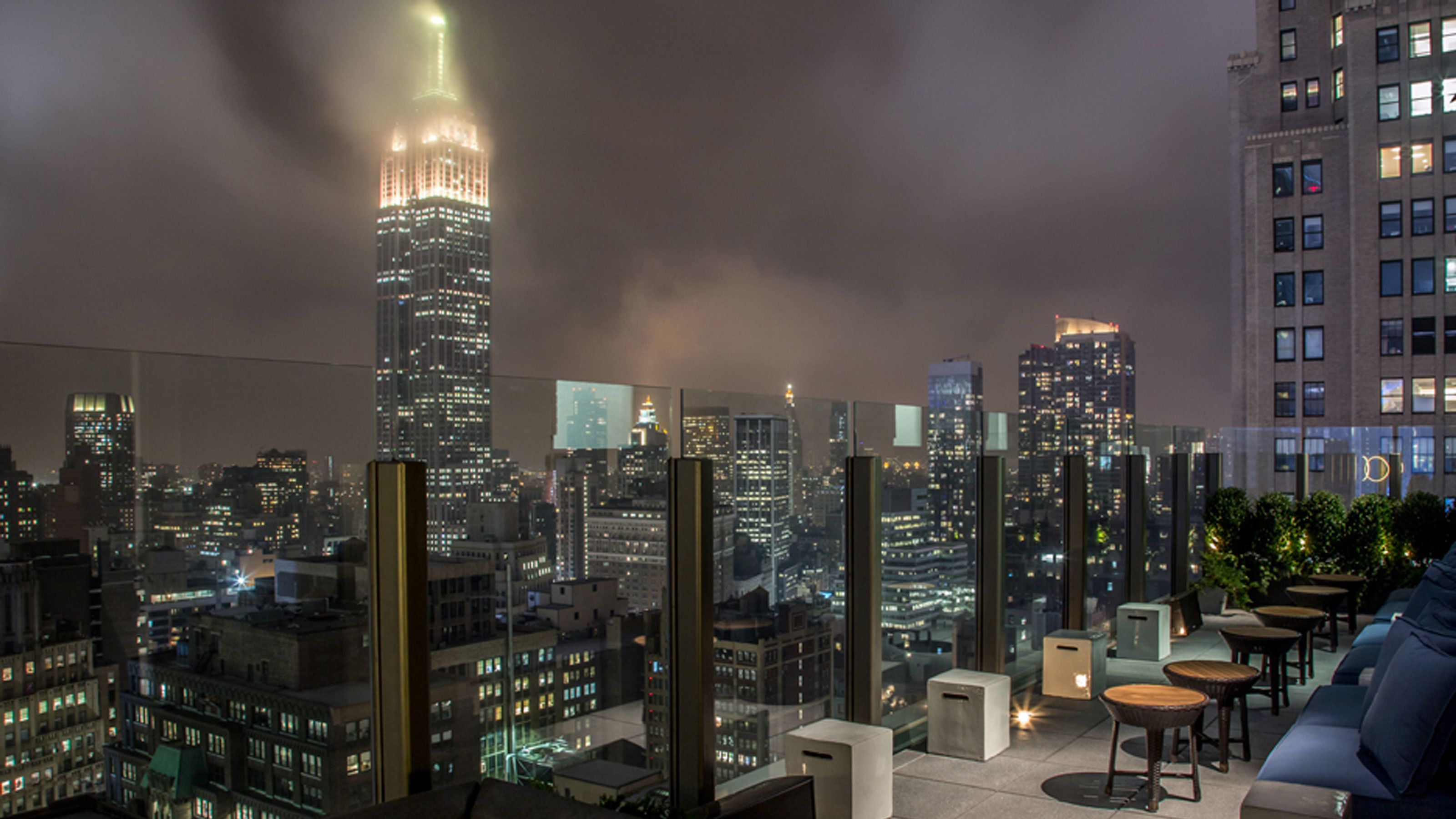 Rooftop view of the Empire State Building at night in New York