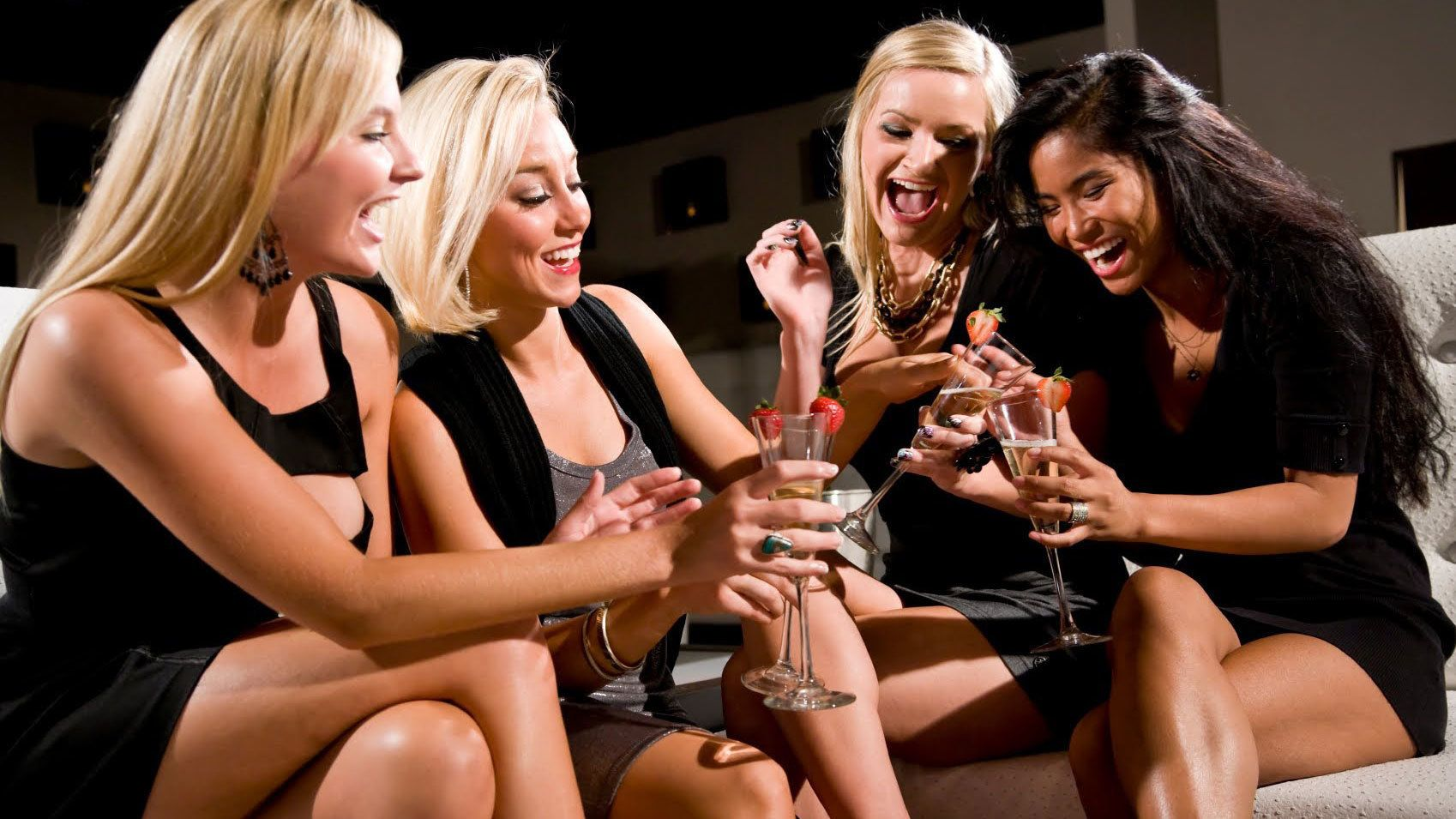 View of some ladies having drinks and laughter inside a nightclub in New York