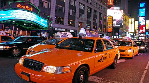 Taxi cabs in New York at night
