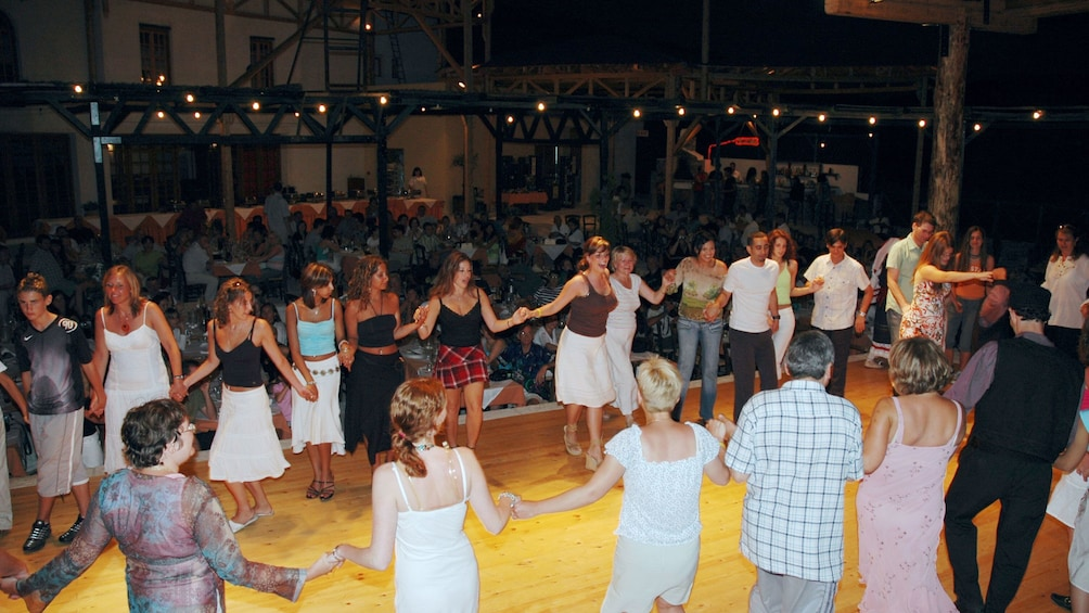 Show item 2 of 10. People doing a traditional greek dance in Crete