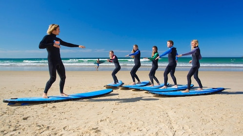 Introduction to surfing on stunning Torquay beach at a Surfing Lesson at the Great Ocean Road