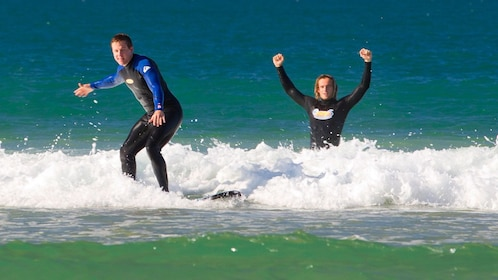 Surfer with instructor in Australia