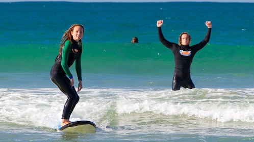 Couple learning how to surf at Anglesea