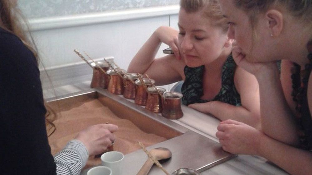 Kids at the traditional coffee making course at a local coffee shop in Istanbul