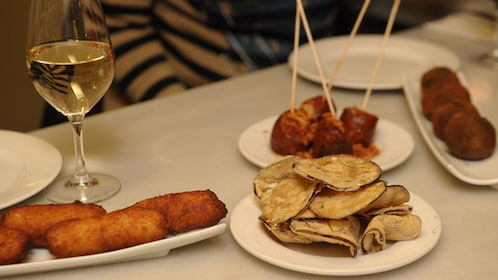 Wine and food on table in Barcelona Spain