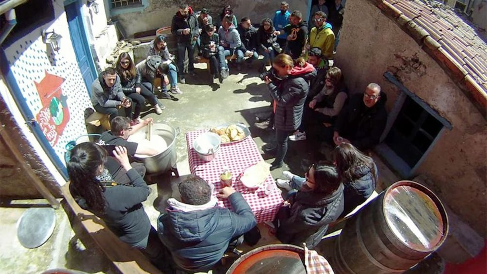 Apri foto 3 di 10. Tour group watching a demonstration in Barbagia
