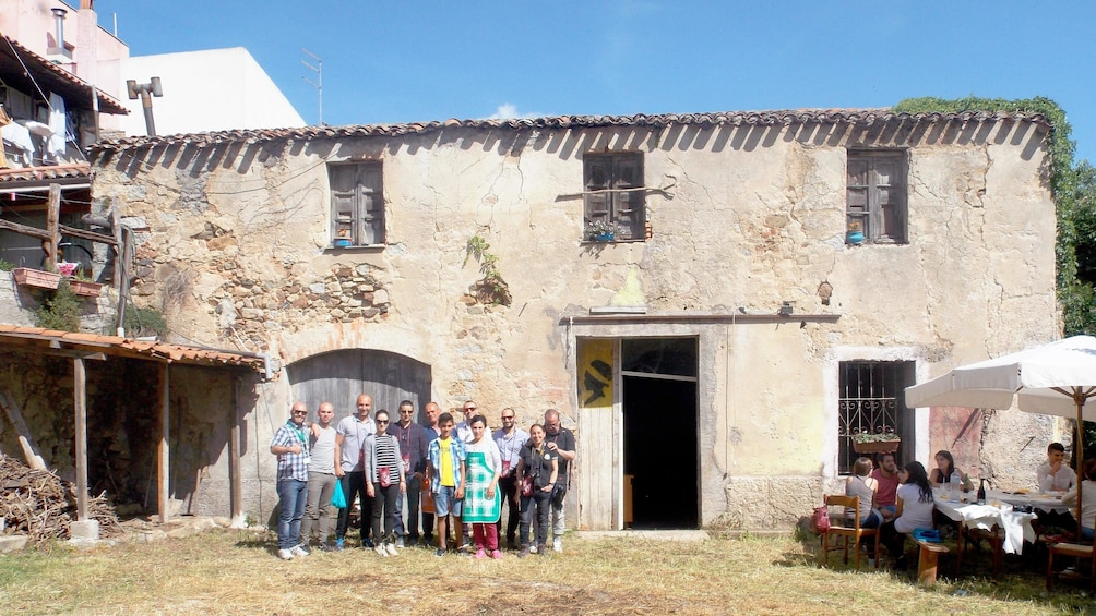 Tour group taking a picture in front of the wine cellar in Cagliari