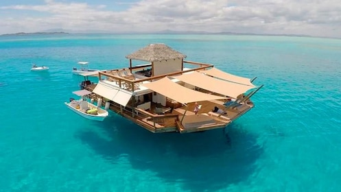 Cloud 9 floating cabana docked in a clear blue sea
