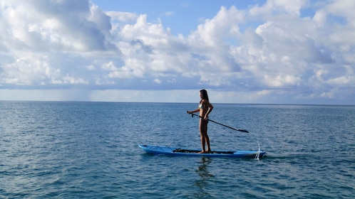 Stand-up paddling woman in Bermuda