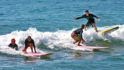 Learning how to surf in water in Los Cabos