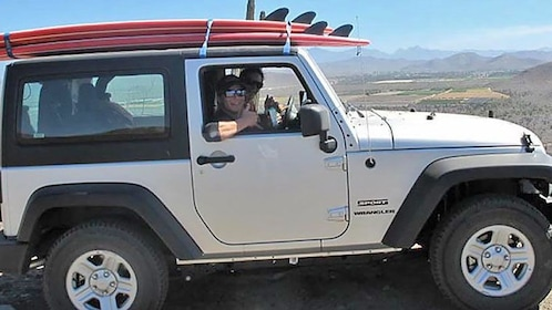 Jeep carrying surf boards in Los Cabos