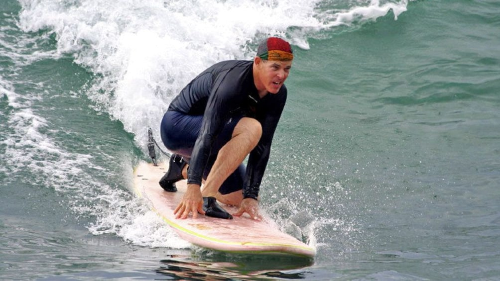 Show item 4 of 10. Catching a wave in Los Cabos