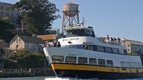Tour boat passing by Alcatraz Island in San Francisco