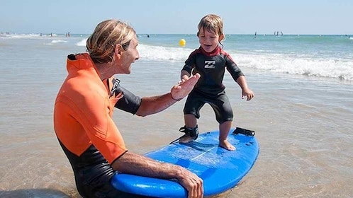 Child learning how to surfboard in Cadiz