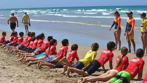 Panoramic view of a group learning how to surfboard in Cadiz