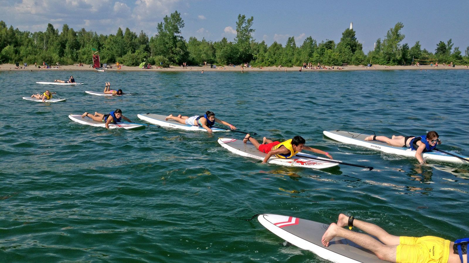 paddling while laying flat on paddleboards in Toronto