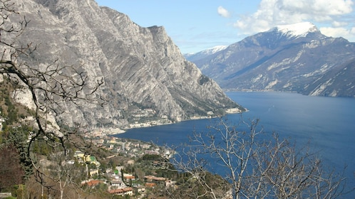 town at the foot of the mountain next to the water in Lake Garda