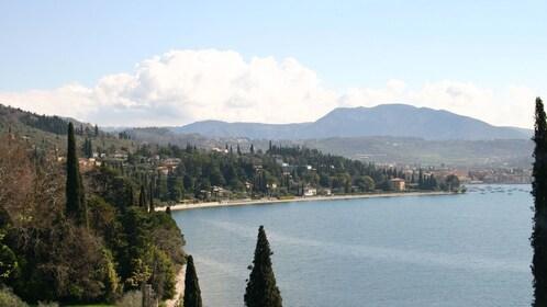 low hanging clouds above the mountains in Lake Garda