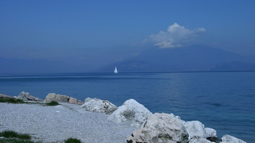 snow covered mountain from a distance in Lake Garda