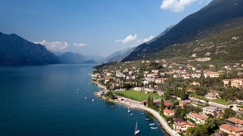 boats along the beach on a clear day in Lake Garda
