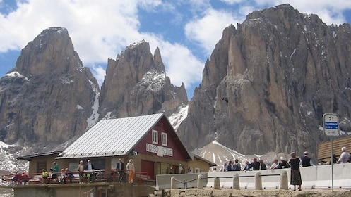 partially snow covered mountains at Dolomites