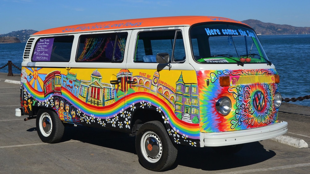 Show item 1 of 5. Colorfully painted tour van in San Francisco