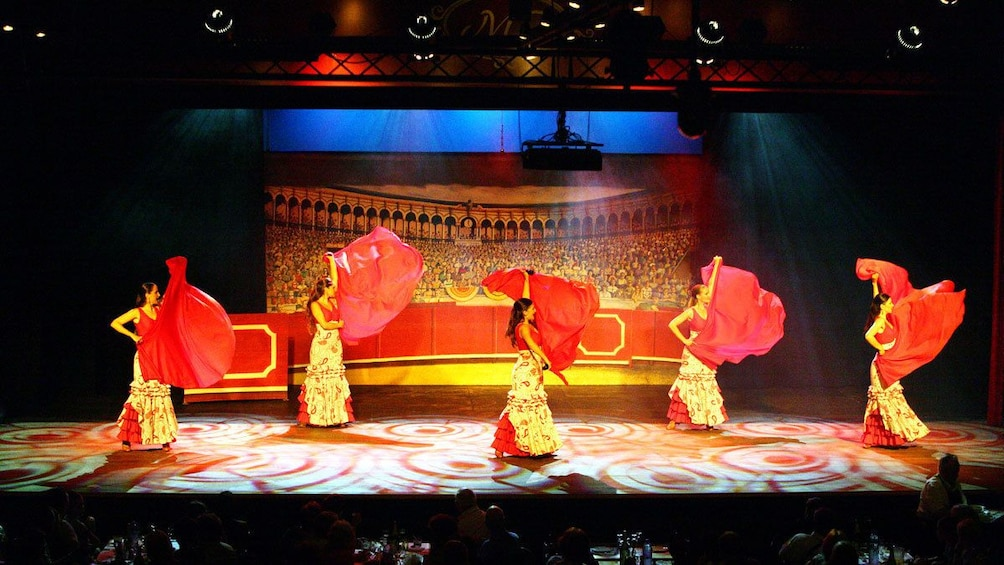 Show item 3 of 5. Women dancing at the Live Flamenco Show at Gran Casino Costa Brava