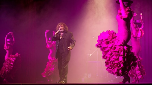Man singing and dancers performing at the Live Flamenco Show at Gran Casino Costa Brava