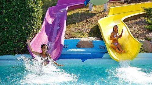 Girls sliding down water slides at Costa Brava