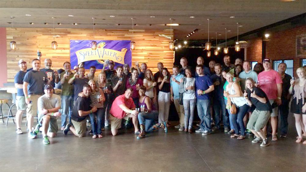 large group socializing at the brewery in Atlanta
