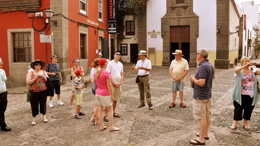Show item 1 of 10. Tour group with guide in Old Town district of Gran Canaria