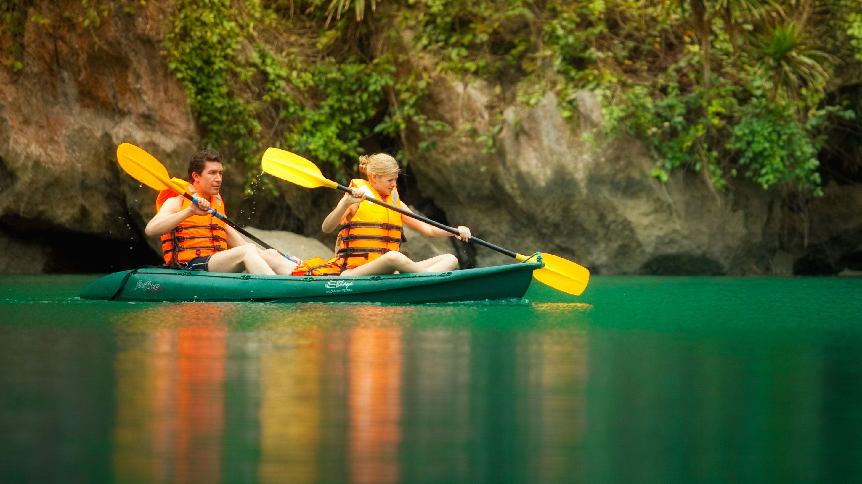 Kayaking couple in Halong Bay