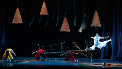 Dancer leaping onstage in the Mist Dance Show in Ho Chi Minh City