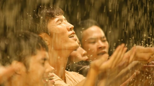 Rain pouring down on actors during the Mist Dance Show in Ho Chi MInh City