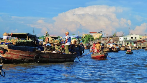 Boats with produce at the Cai R?ng floating market in the Mekong Delta